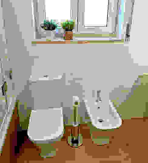 Sanita e bidé em casa de banho (Ribamar - Ericeira) Decor-in, Lda Banheiros modernos Cerâmica Branco