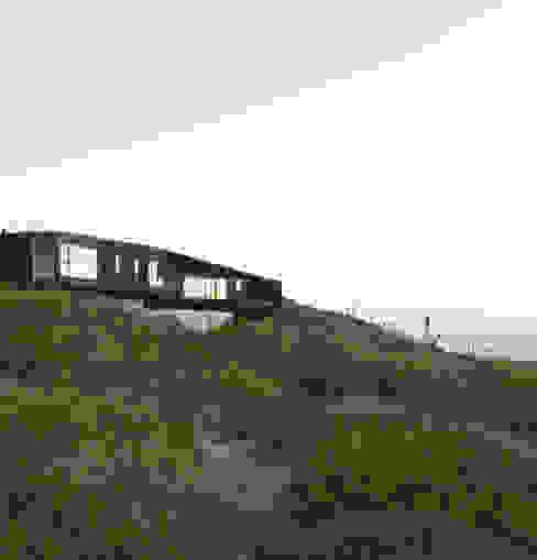 Casa Estirada de Whale! Minimalista Madera Acabado en madera