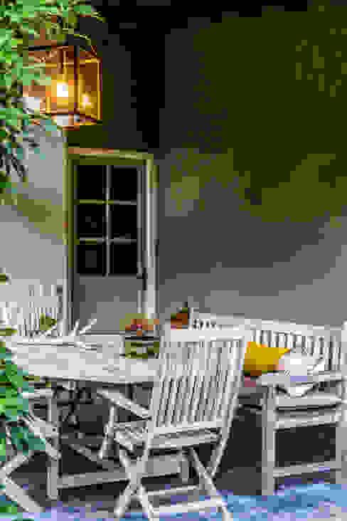 Schilder de buitenmuur met Kalei voor een kleuraccent van Pure & Original Landelijk