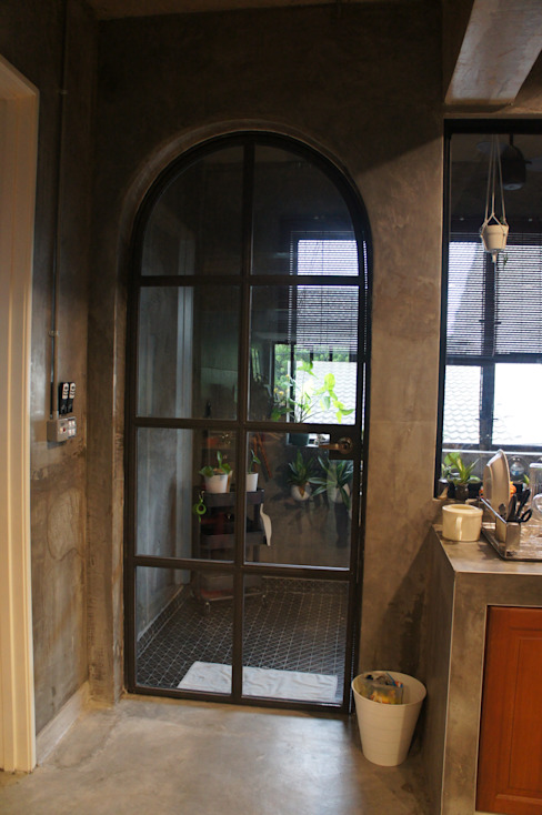 Vintage round top door N O T Architecture Sdn Bhd Industrial style doors