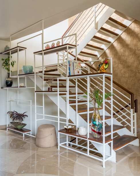 Staircase with natural wood steps by Art Space Design studio Modern