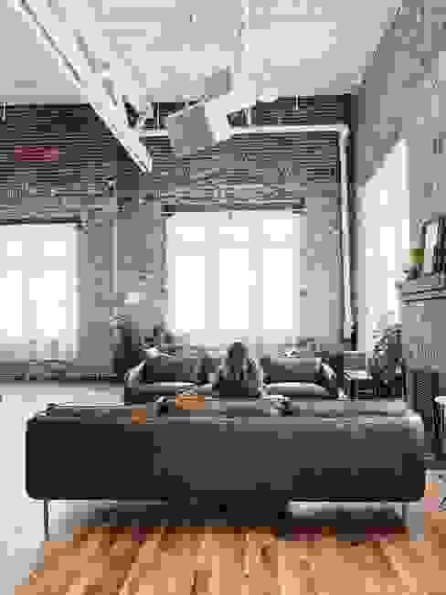 Leben im hippen Loft-Stil Floorwell Industriale Wohnzimmer Holz