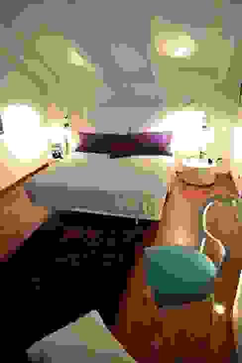 Camera da letto Silvia Camporeale Interior Designer Camera da letto piccola Legno Bianco