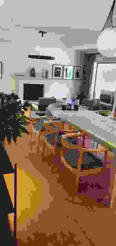 Dining room facing open plan lounge with fireplace Deborah Garth Interior Design International (Pty)Ltd Dining roomTables Wood White
