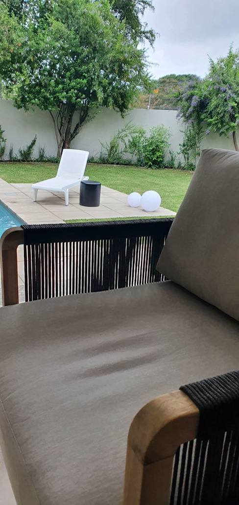 Patio facing pool Deborah Garth Interior Design International (Pty)Ltd Pool Wood Grey