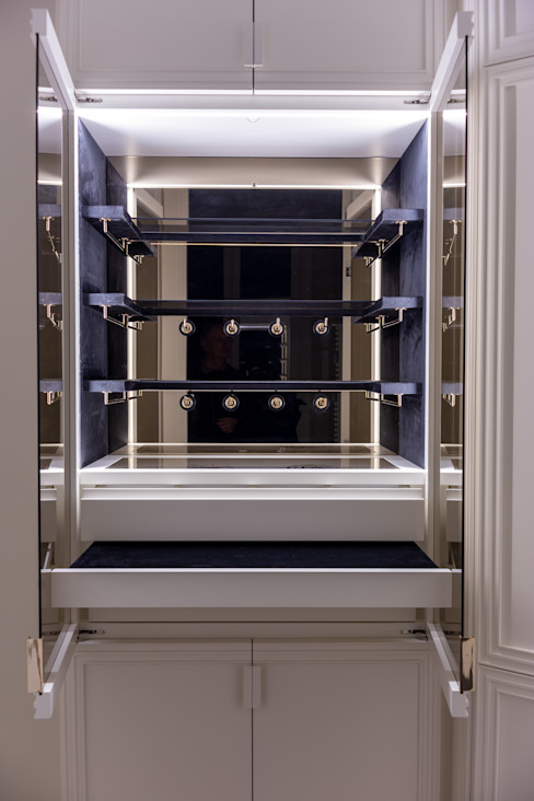 A wardrobe with a compartment for accessories decorated with velvet, bronzed mirrors and accessories holder in brass with champagne-color finishing Tognini Bespoke Furniture Living roomCupboards & sideboards Glass Black