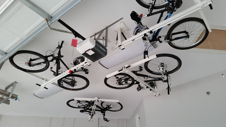 Modern Garage and Shed by flat-bike-lift Modern