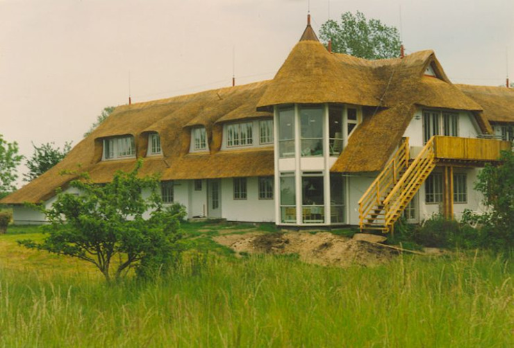 Casas por Die Dachdecker Neumann GmbH