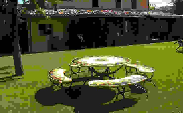 Arredare il proprio giardino con un opera d'arte: Tavoli in