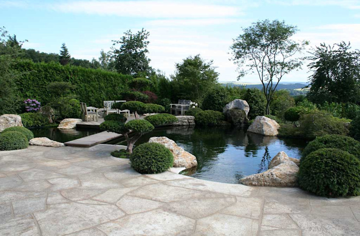 Сад в стиле модерн от Kirchner Garten & Teich GmbH Модерн