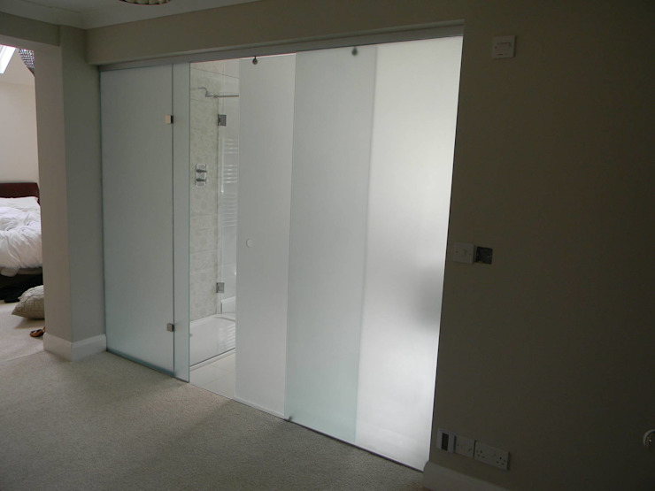 Frosted Glass Sliding Door partition in Cambridge od Go Glass Ltd Nowoczesny