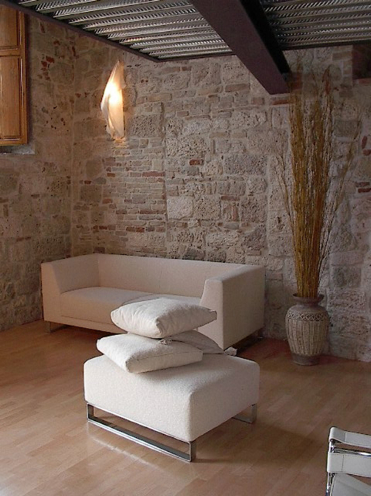 Salones rústicos rústicos de Fabio Barilari Architetti Rústico