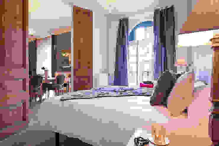 PISO ROMANTICO EN PLENO CENTRO DE BARCELONA Dormitorios de estilo clásico de Home Deco Decoración Clásico