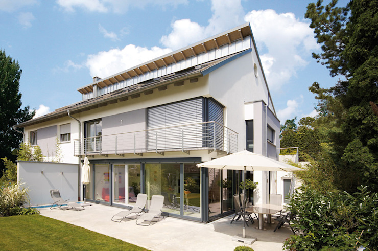 AUSSERGEWÖHNLICHE DOPPELHAUSHÄLFTE Moderne Häuser von b2 böhme BAUBERATUNG Modern