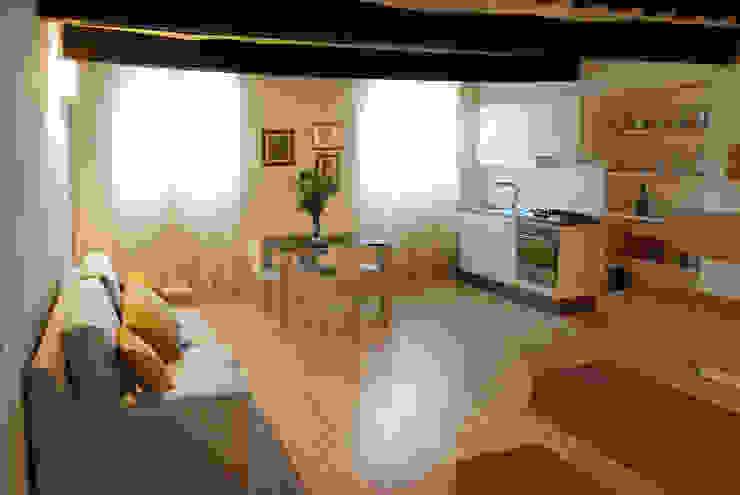 Villa Luce_Appartamento D Soggiorno in stile rustico di OPERASTUDIO Rustico