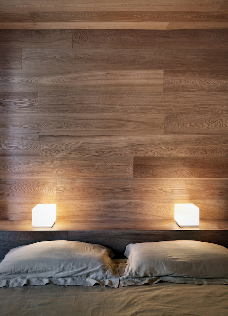 Dormitorios modernos: Ideas, imágenes y decoración de es-arch Moderno
