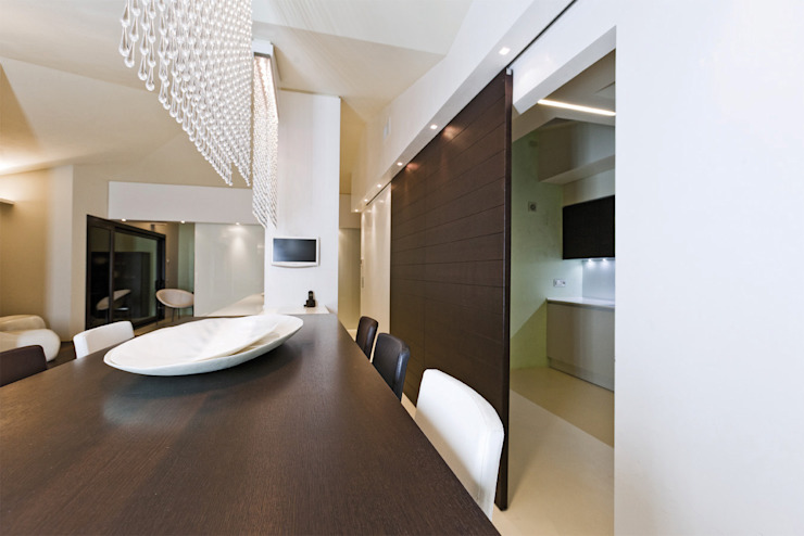 Casa Victoire Sala da pranzo moderna di Enrico Muscioni Architect Moderno