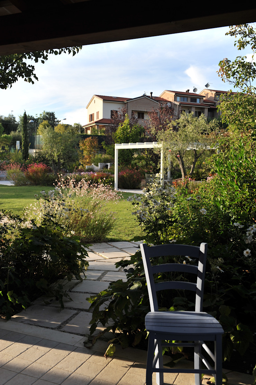 Un'oasi verde nel cuore della città Giardino eclettico di Giardini Giordani Eclettico