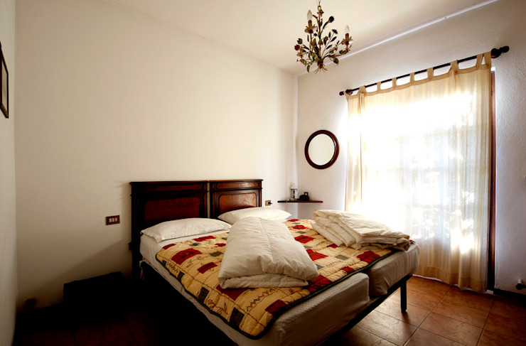 Villa Lago Maggiore – Italia Camera da letto in stile rustico di Marco Barbero Rustico