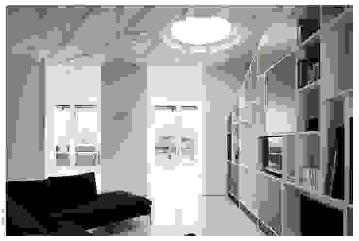 Penthouse bioclimatica a forma di cappello. Soggiorno eclettico di Garbadellarchitetti Eclettico