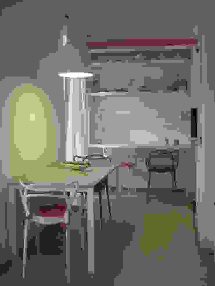 _Zona pranzo Case moderne di Idealarchitecture Moderno