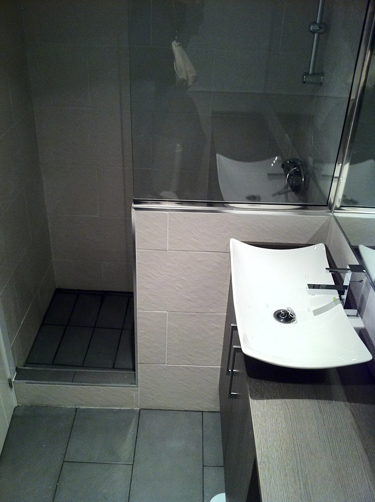 Reforma de baños de Tatiana Doria, Diseño de interiores Moderno