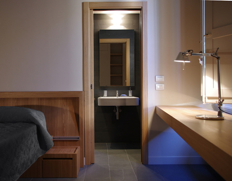 Alloggio in Via dei Pilastri Camera da letto moderna di G. Giusto - A. Maggini - D. Pagnano Moderno