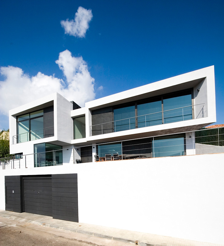 House at Pineda de Mar Houses by Octavio Mestre Arquitectos