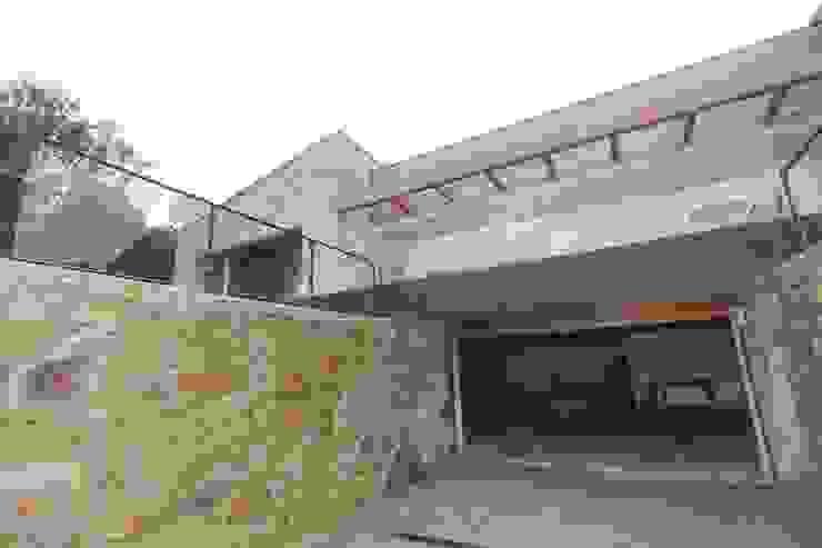 Casas de estilo rústico de HUGA ARQUITECTOS Rústico