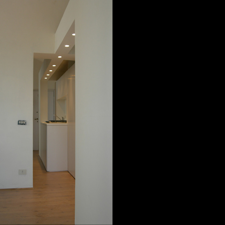 CASA DELLO SCULTORE Ingresso, Corridoio & Scale in stile moderno di DELISABATINI architetti Moderno