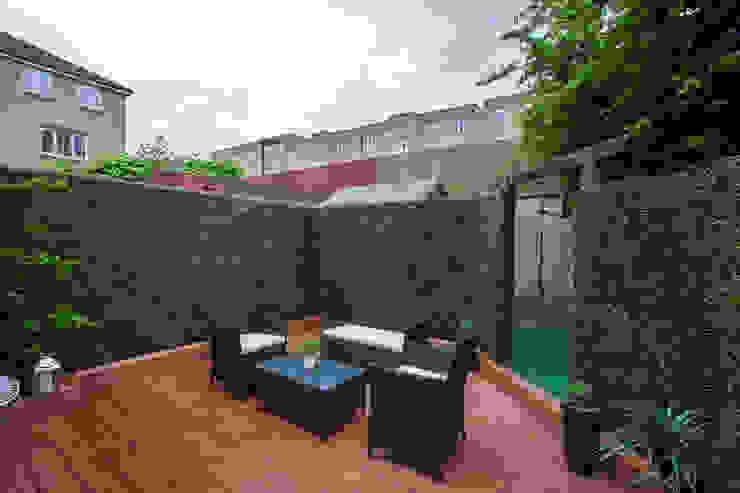 Garden - Canary Wharf Millennium Interior Designers Jardines de estilo moderno