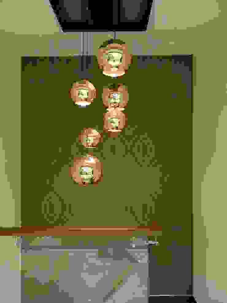 copper lights in the stairwell Modern corridor, hallway & stairs by Hasta architects Modern