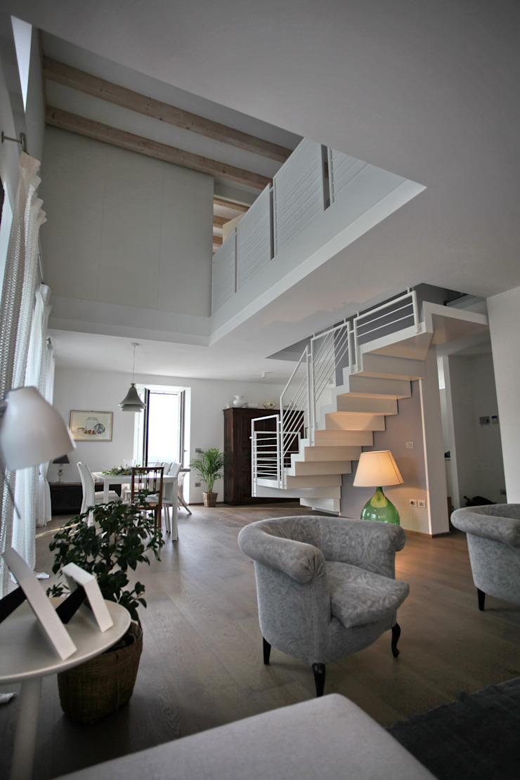 la zona giorno Soggiorno moderno di luca pedrotti architetto Moderno