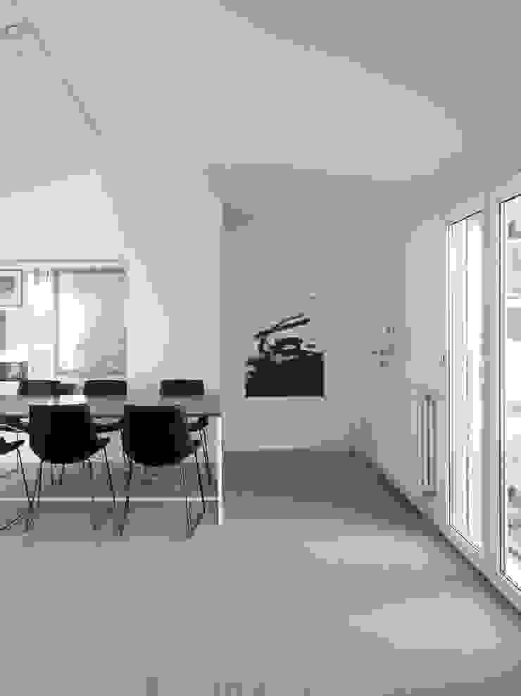 Casa EG Negozi & Locali commerciali moderni di Nuovostudio Architettura e Territorio Moderno