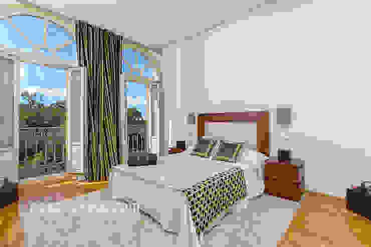Dormitorios modernos: Ideas, imágenes y decoración de Espacios y Luz Fotografía Moderno
