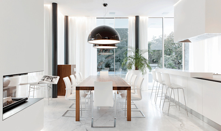 Modern dining room by monovolume architecture + design Modern