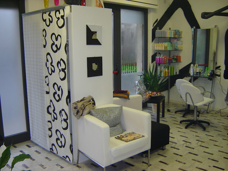 Eclectic style offices & stores by Luca Bucciantini Architettura d' interni Eclectic