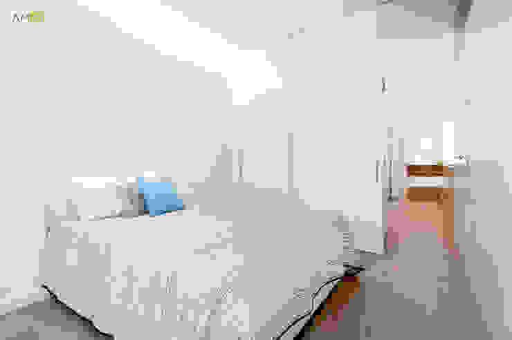 ATICO EN JOAQUIN COSTA Dormitorios de estilo ecléctico de amBau Gestion y Proyectos Ecléctico