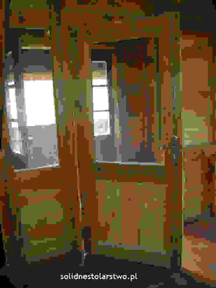 Drzwi drewniane, ręcznie rzeźbione od Zakład Stolarski Robert Latawiec Wiejski