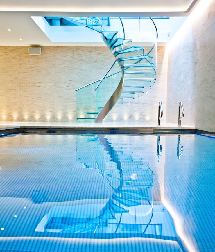 Pool & Wellness Area with Spiral Staircase Modern pool by London Swimming Pool Company Modern