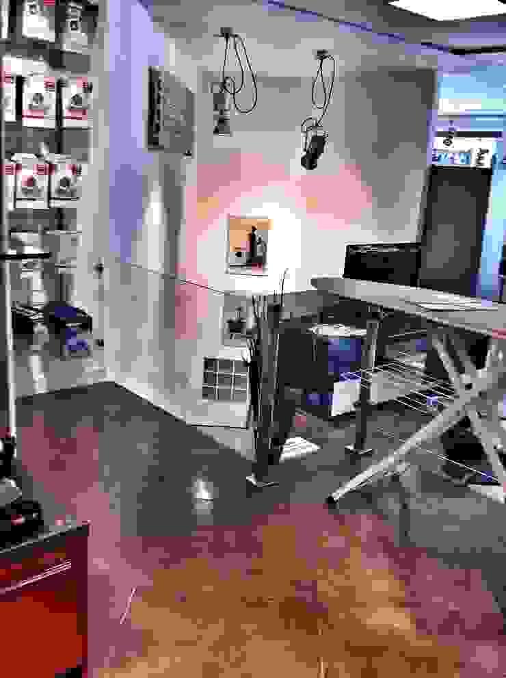 Showroom Miele Spazi commerciali moderni di Giulia Villani - Studio Guerra Moderno