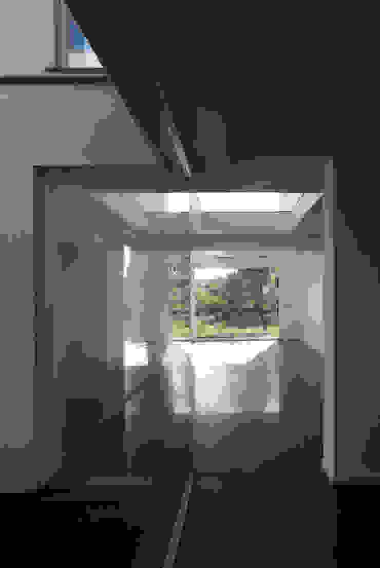casa A Ingresso, Corridoio & Scale in stile moderno di grecoarchitetture Moderno