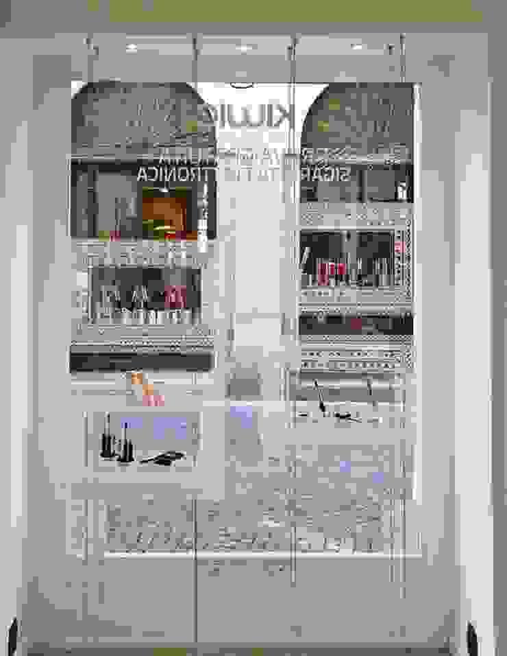 KIWIE FASHION CLOUD di NOMADE ARCHITETTURA E INTERIOR DESIGN Eclettico