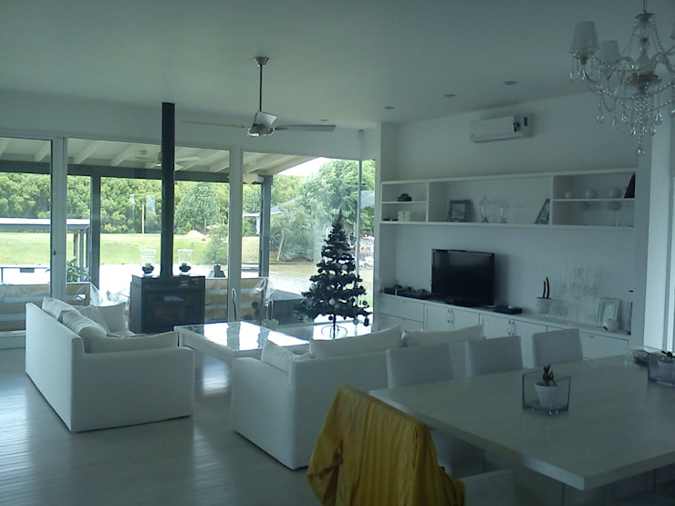 Modern Living Room by 2424 ARQUITECTURA Modern