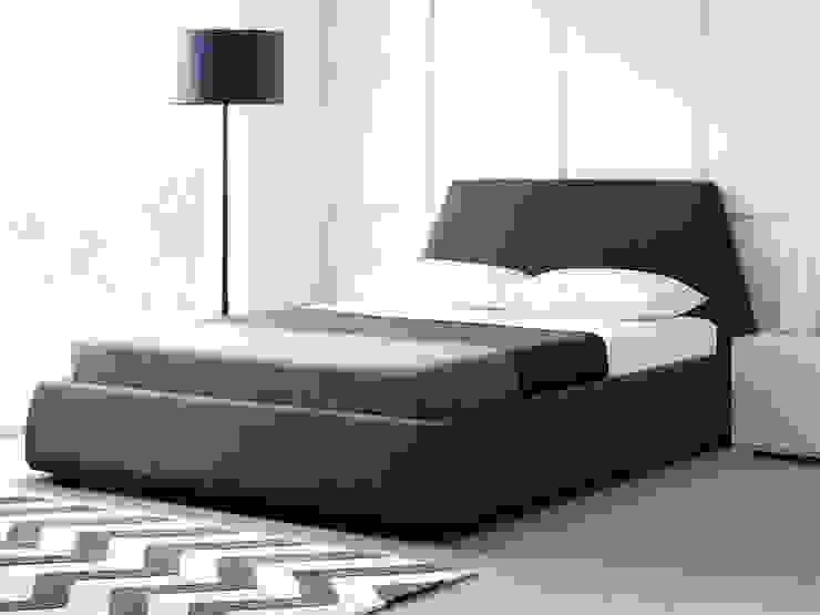 Dormitorios de estilo  por Living It Up,