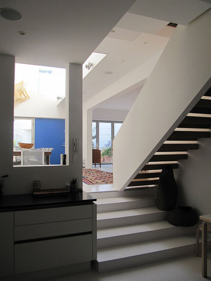 The kitchen Modern corridor, hallway & stairs by 4D Studio Architects and Interior Designers Modern