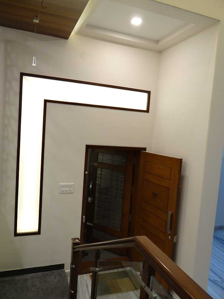 The Entrance Door - witha backlit window Modern corridor, hallway & stairs by Hasta architects Modern