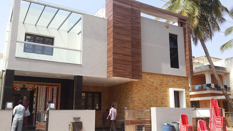North elevation with Stone and Fundermax cladding:  Houses by Hasta architects