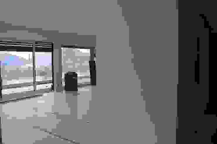 Penthouse Lugano di NOMADE ARCHITETTURA E INTERIOR DESIGN Moderno
