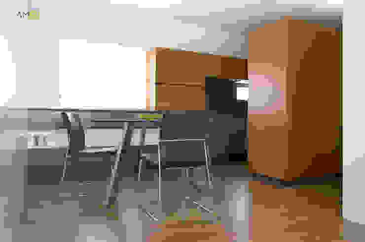 amBau Gestion y Proyectos Sala da pranzo eclettica